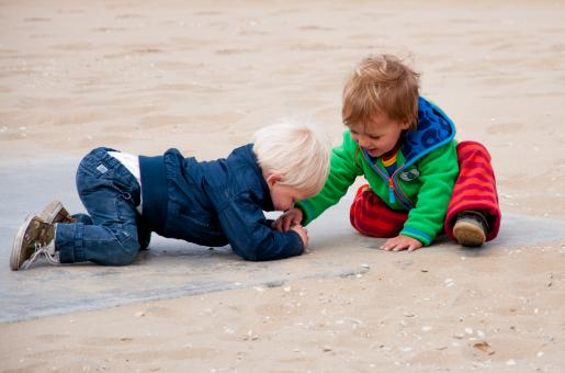Kids playing on the beach - Free Stock Photo