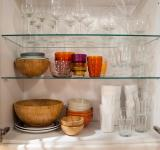Free Photo - Opened cupboard with kitchenware inside