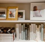 Free Photo - Bookshelves with books and photo frames