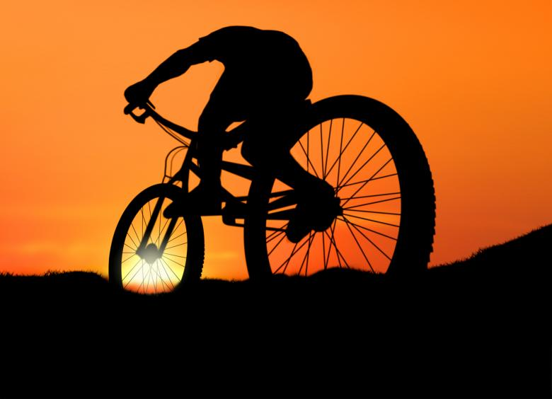 Biking into the Sunset - Free Fitness Stock Photos