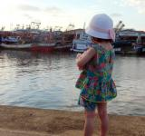 Free Photo - Girl Looking at Fishing Boats
