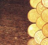 Free Photo - Euro coins on old wooden background