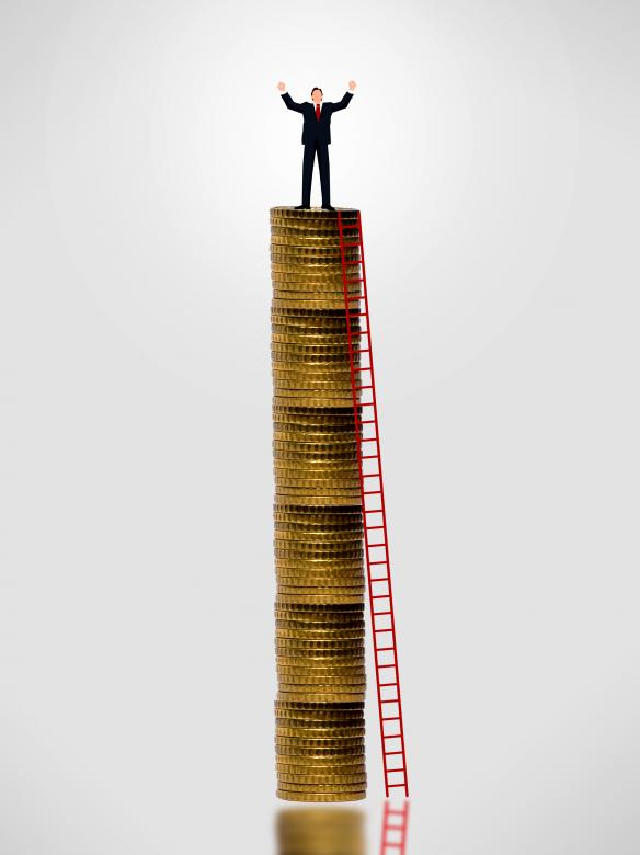 Free Stock Photo of Businessman on top of gold coin stack Created by Jack Moreh