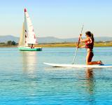 Free Photo - Woman practicing stand-up paddle