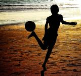 Free Photo - Silhouette of a boy playing soccer