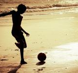 Free Photo - Boy on the beach playing football