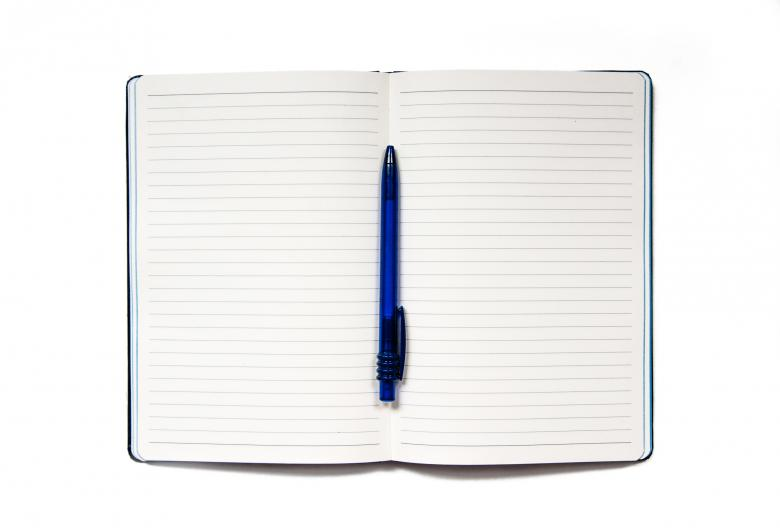 Notebook with pen isolated on white Free Photo