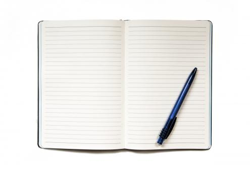 Notebook with pen isolated on white - Free Stock Photo