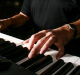 Free Photo - Man playing keyboard piano