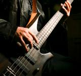 Free Photo - Man playing electric bass
