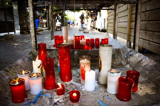 Prayer candles burning in lourdes - Free Stock Photo