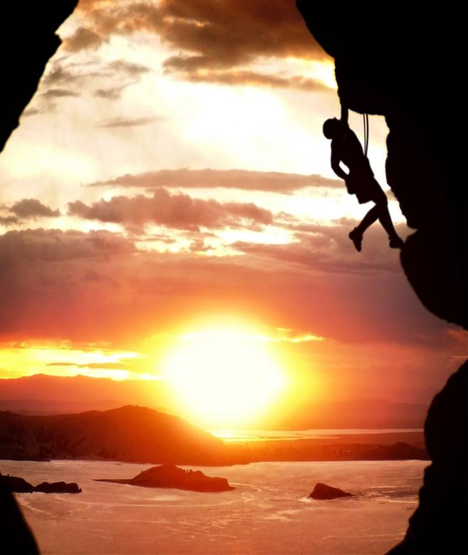 Free Stock Photo of Free-climber rising at sundown Created by Jack Moreh