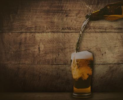 Pouring beer - washed out vintage look - Free Stock Photo