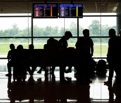 Passenger Silhouettes at Airport - Free Stock Photo