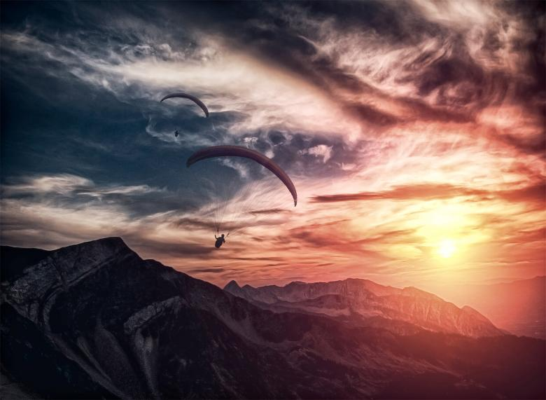 Free Stock Photo of Into the atmosphere - Paragliding over mountain ridge Created by Jack Moreh