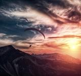 Free Photo - Into the atmosphere - Paragliding over mountain ridge