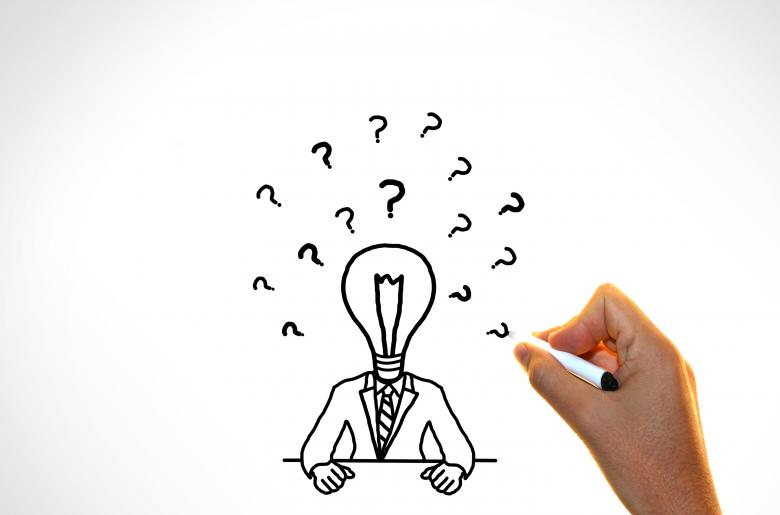 Free Stock Photo of Doubts and ideas concept - Businessman with questions marks Created by Jack Moreh