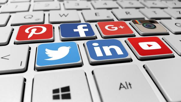 Social media networks on the computer keyboard - Free Stock Photo