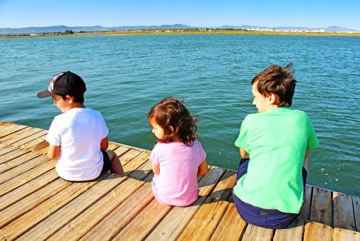 Three kids on the pier - Free Stock Photo