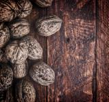 Free Photo - Whole walnuts on rustic old wooden table - With copyspace