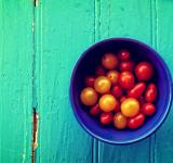 Free Photo - Fresh colorful cherry tomatoes on wood background - Organic farming