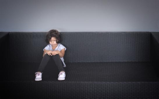Sulky and angry young kid on the couch - Free Stock Photo