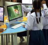 Free Photo - School students using Apple Macs