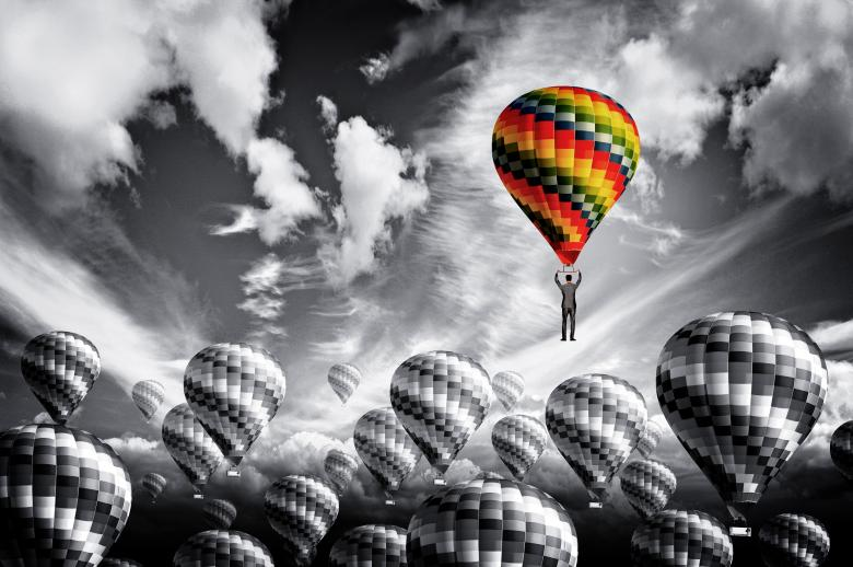 Free Stock Photo of Businessman leader rising in a hot air balloon - Leadership concept