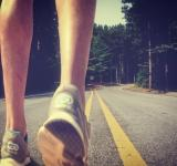 Free Photo - Feet of an athlete running on a deserted road