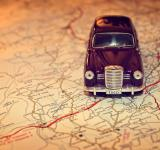 Free Photo - Hit the road - Travel concept with vintage miniature car on road map