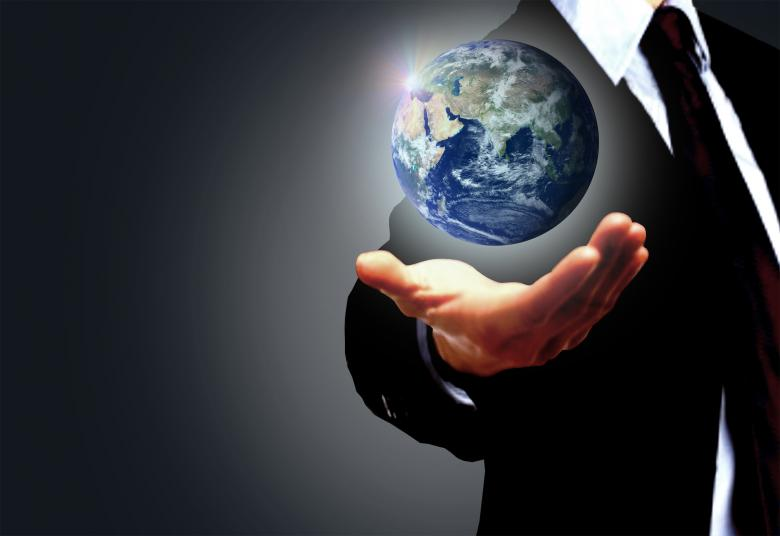 Free Stock Photo of Hand of a businessman holding Earth globe - Globalization concept Created by Jack Moreh