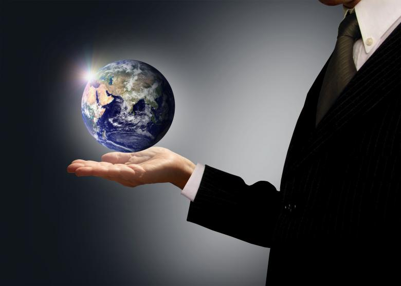 Free Stock Photo of Businessman holding Earth globe - Globalization concept Created by Jack Moreh