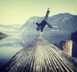 Free Photo - Young boy handstanding on jetty