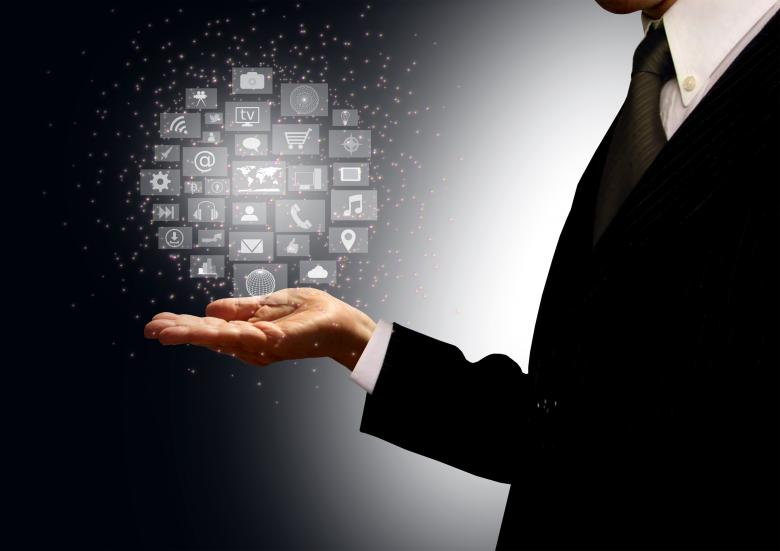 Businessman holding information technology hologram in his palm - Free Business Illustrations