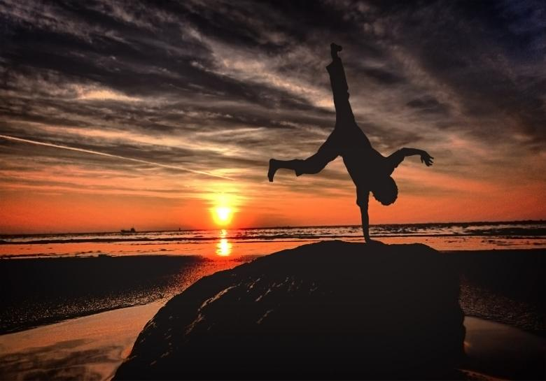 Free Stock Photo of Handstanding on the beach at sunset - Youth and vitality Created by Jack Moreh