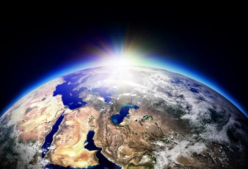 Sun rising over planet Earth - Free Stock Photo