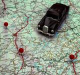 Free Photo - Miniature car and pushpins on a map - Travel concept