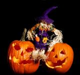 Free Photo - Scarecrow sitting on Pumpkins