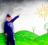 Free Photo - Happy child drawing a sunny landscape