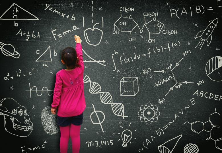 Free Stock Photo of Little girl writing on blackboard Created by Jack Moreh