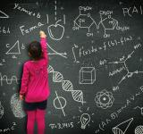 Free Photo - Little girl writing on blackboard