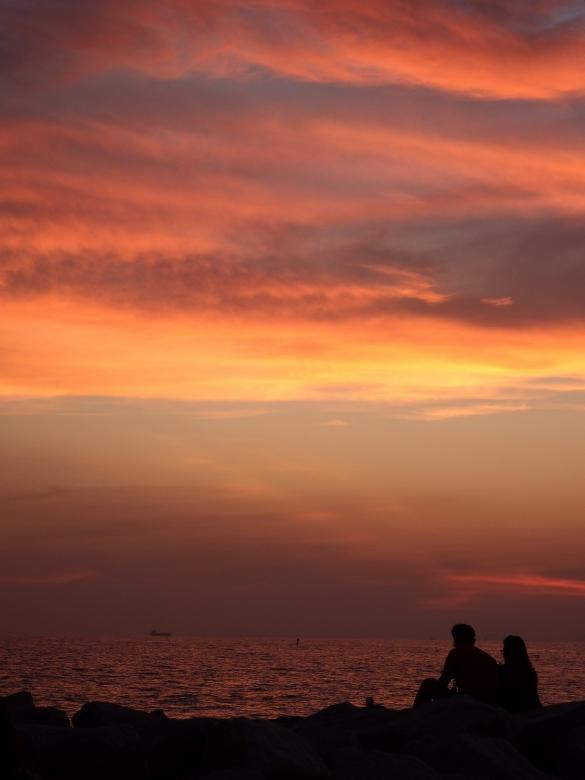 Free Stock Photo of Couple Sit and Watch the Sunset Created by Ivan