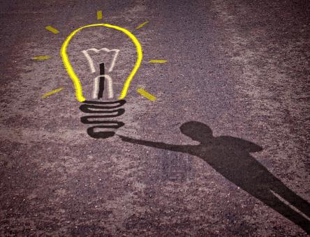 Shadow of a boy touching a lightbulb drawing - Free Stock Photo