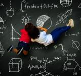 Free Photo - Two little girls writing on a blackboard with science subjects