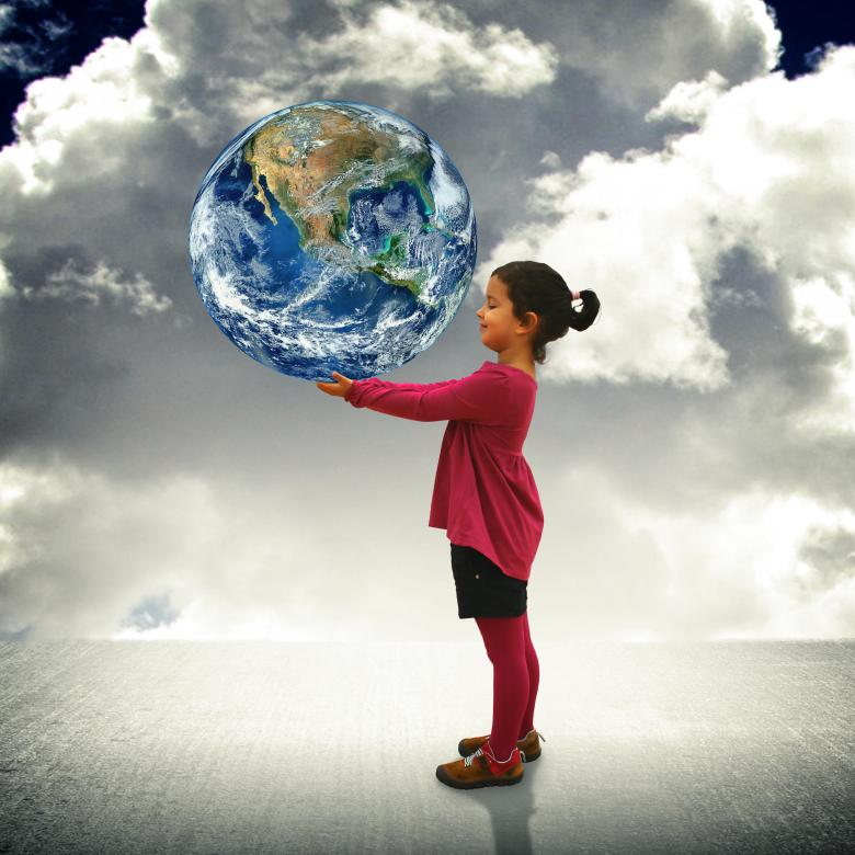 Child holding the world in her hands Free Photo