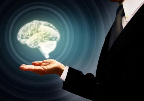 Businessman holding a brain in the palm - Skills concept - Concentric - Free Stock Photo