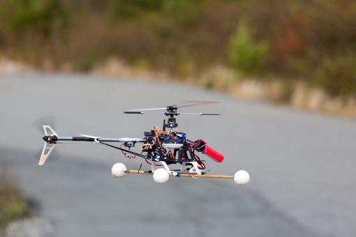 Drone flying over road - Free Stock Photo