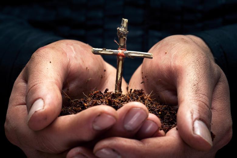 Cross in the hands - Free Easter Stock Photos & Vectors