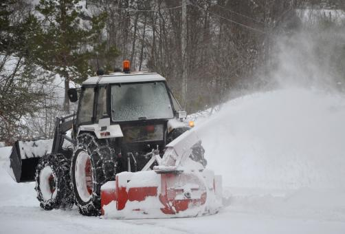 Tractor clearing the snow - Free Stock Photo