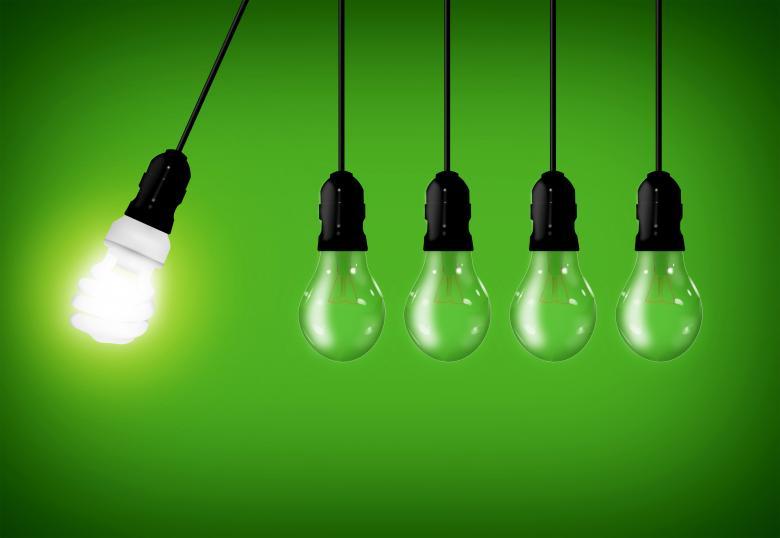 Eco Concept - Energy Saver Lightbulb Among Common Lightbulbs - Free Environmental Stock Photos